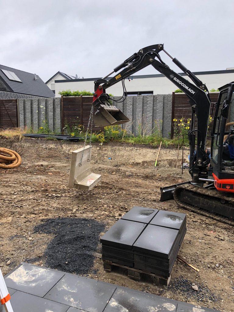 Halimi Pflasterbau Projekte Bewegung von Bodenplatten und anderen Werkstoffen auf einer Baustelle